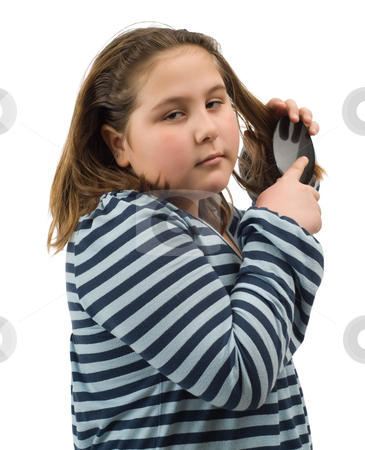 Child Brushing Her Hair stock photo, A young girl brushing her hair, isolated against a white background by Richard Nelson