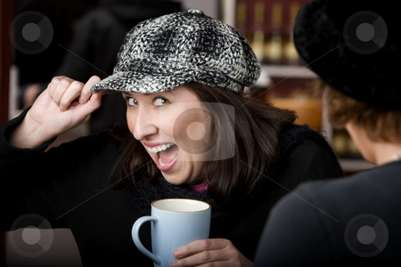 Hispanic woman with coffee stock photo, Pretty Hispanic woman with coffee and a big smile by Scott Griessel