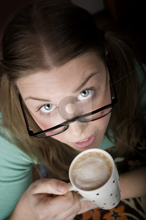Pretty Young Woman with Coffee stock photo, Pretty young woman with glasses and small coffee cup by Scott Griessel
