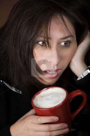 Woman in need of coffee stock photo, Half awake woman cradling a mug of coffee by Scott Griessel