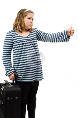 Child Hitchhiking stock photo, A young girl hitchhiking, isolated against a white background by Richard Nelson