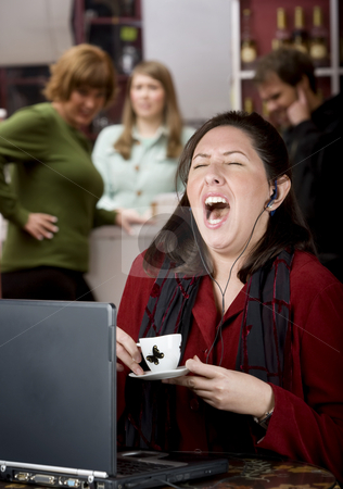 Obnoxious young woman singing loudly stock photo, Obnoxious young woman singing loudly in a coffee house by Scott Griessel