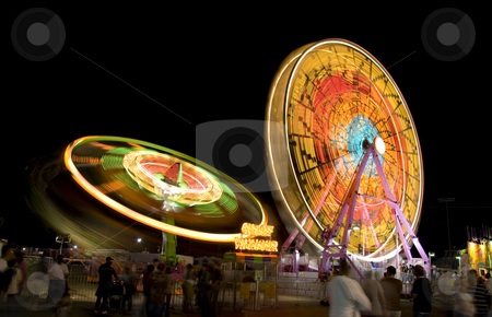 Fair rides at night stock photo, Fair rides from a state fair viewed at night with a long shutter speed. by Robert Ranson