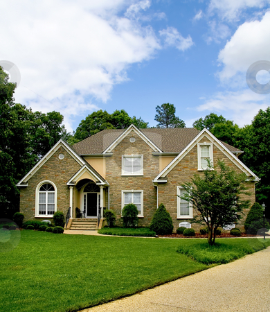 Modern house stock photo, Modern stone house with well kept yard. by Robert Ranson