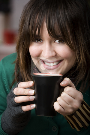 Pretty Young Woman with Coffee stock photo, Pretty Young Girl with Coffee in a Mug and Foam on her Lip by Scott Griessel