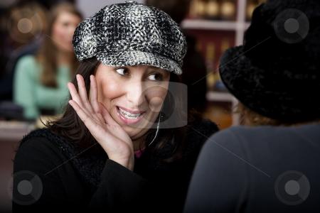 Hispanic woman with coffee stock photo, Pretty Hispanic woman with coffee sharing gossip by Scott Griessel