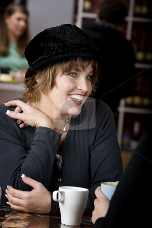 Woman with Friend in Coffee House stock photo, Pretty adult woman with friend in a coffee house by Scott Griessel
