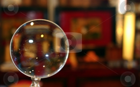Magnifying Glass stock photo, A magnifying glass showing a store in the background by Henrik Lehnerer