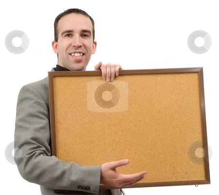 Display stock photo, A young businessman holding up some corkboard for your text, isolated against a white background by Richard Nelson