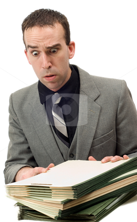 Busy Businessman stock photo, A busy businessman with a pile of files in front of him, isolated against a white background by Richard Nelson
