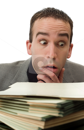 Busy Businessman stock photo, Closeup view of a businessman with file folders out of focus in front of him, isolated against a white background by Richard Nelson