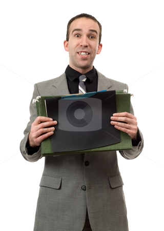 Busy Businessman stock photo, A busy businessman holding his files, isolated against a white background by Richard Nelson
