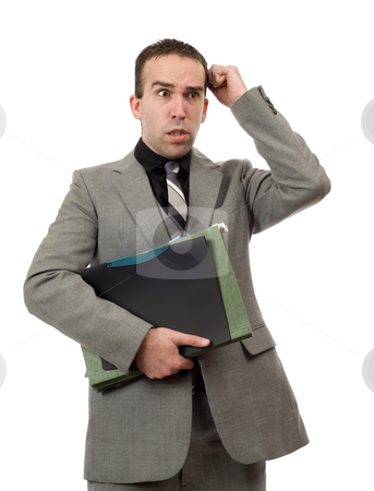 Angry Businessman stock photo, An angry businessman pulling out his hair, isolated against a white background by Richard Nelson