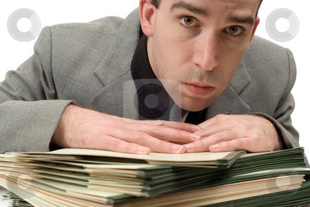 Worried Businessman stock photo, Closeup view of a worried businessman with too much work to do by Richard Nelson