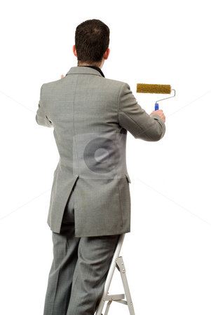 Businessman Painting Your Text stock photo, Behind view of a businessman painting something, isolated against a white background by Richard Nelson