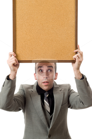 Businessman Holding A Sign stock photo, A young businessman holding a sign above his head, isolated against a white background by Richard Nelson