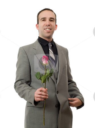 Romantic Man stock photo, A romantic man wearing a suit and holding a rose, isolated against a white background by Richard Nelson