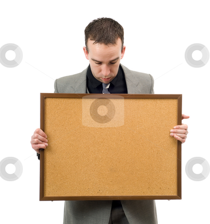 Your Text Here stock photo, Businessman holding a corkboard and looking down at your text by Richard Nelson