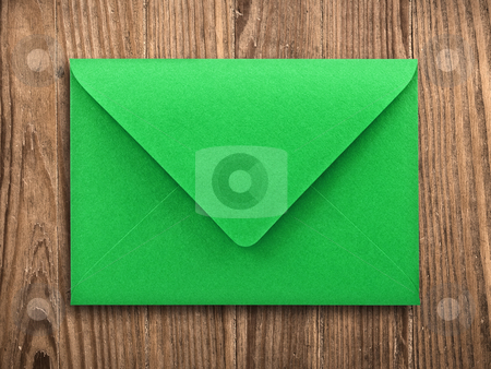 Blank envelope on old table, clipping path. stock photo, Green envelope on old wooden table, with clipping path. by Pablo Caridad
