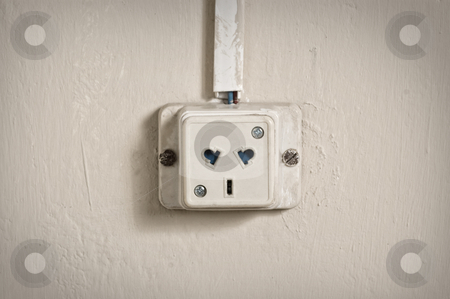 Electric outlet in old wall. stock photo, Electric outlet in a wall in an old house interior by Pablo Caridad