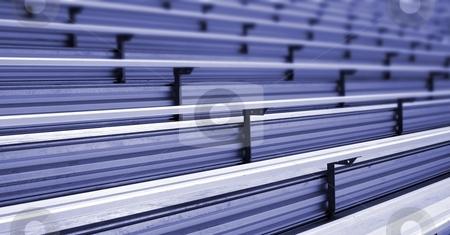 Bleachers stock photo, Bleachers in a stadium or school for the fans by Henrik Lehnerer