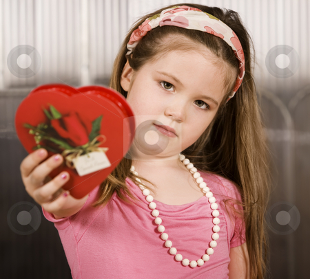 Cute young girl with Valentine stock photo, Cute little girl with a Valentine in her hand by Scott Griessel