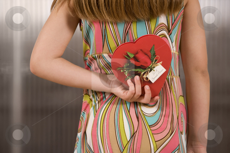 Girl with Valentine stock photo, Little girl holding a Valentine behind her back by Scott Griessel