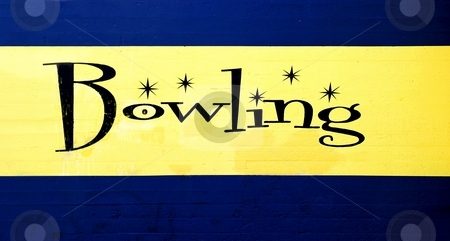 Bowling stock photo, Blue and yellow vintage bowling center sign. by Henrik Lehnerer