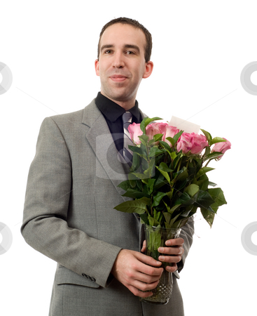 Man On A Date stock photo, A young man holding a vase of roses, isolated against a white background by Richard Nelson