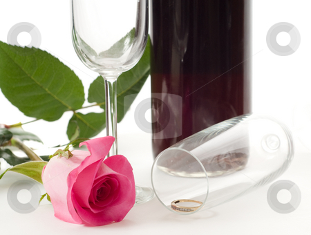 Engagement stock photo, Marriage proposal setup with a ring in a wine glass with a rose and a bottle of wine by Richard Nelson
