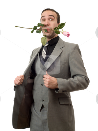 Man With Rose In Mouth stock photo, A young man wearing a suit and holding a rose in his mouth, isolated against a white background by Richard Nelson