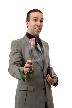 Rose And Champagne stock photo, A man wearing a suit and tie, holding a rose and a bottle of champagne, isolated against a white background by Richard Nelson