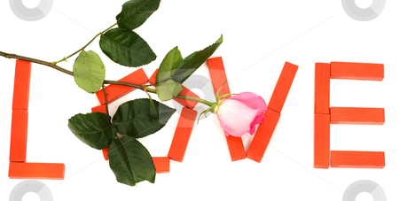 Love stock photo, The word love spelled with red blocks and a pink rose by Richard Nelson
