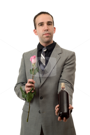 Going On A Date stock photo, A young man dressed in a suit and holding a rose and a bottle of wine, isolated against a white background by Richard Nelson