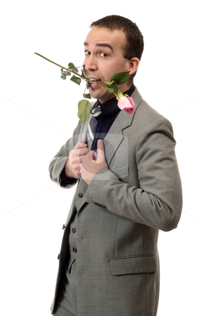 Courting Man stock photo, A young man with a rose in his mouth, isolated against a white background by Richard Nelson