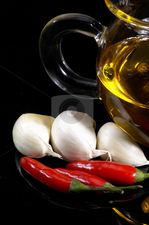 Garlic extra virgin olive oil and red chili pepper stock photo, Garlic olive oil and red chili pepper by Francesco Perre