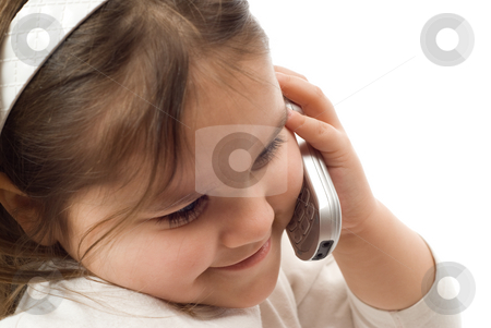 Child Phone Conversation stock photo, A young girl having a phone conversation on a cellphone by Richard Nelson