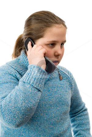 Serious Phone Conversation stock photo, A young girl having a serious conversation on a cell phone, isolated against a white background by Richard Nelson