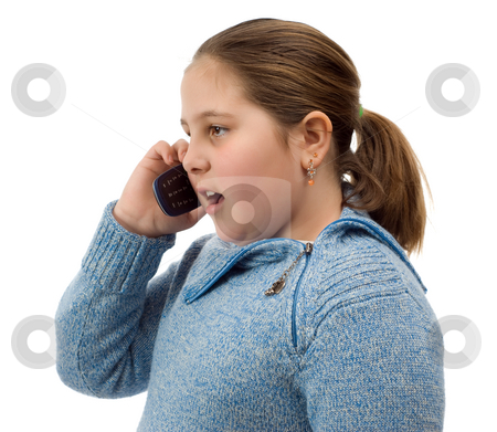 Girl Talking On The Phone stock photo, A young girl talking on a cell phone, isolated against a white background by Richard Nelson