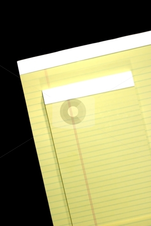 Notepads stock photo, Two standard yellow notepads on black background. by Henrik Lehnerer