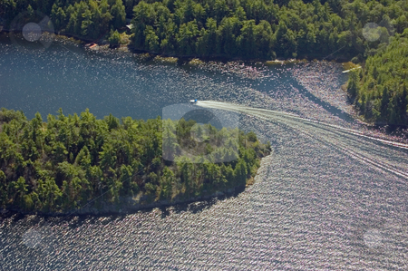 Boat tracks stock photo, Small boat tracks on surface of water in sunlit by Pavel Cheiko