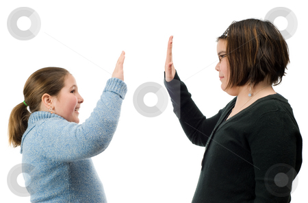 High Five stock photo, Two young girls giving each other a high five with their hands, isolated against a white background by Richard Nelson