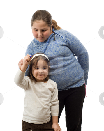 Helping Hand stock photo, An older sister helping her younger one, write something, isolated against a white background by Richard Nelson