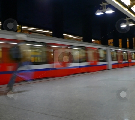 Catching the subway stock photo, Man running to catch the metro in Warsaw by Laurent Dambies