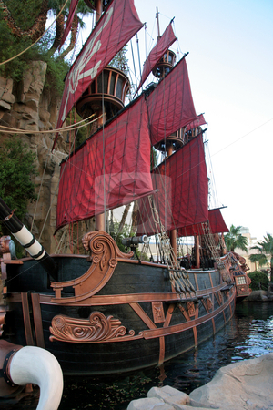 Pirate Ship stock photo, A black and red pirate ship one water by Kevin Tietz