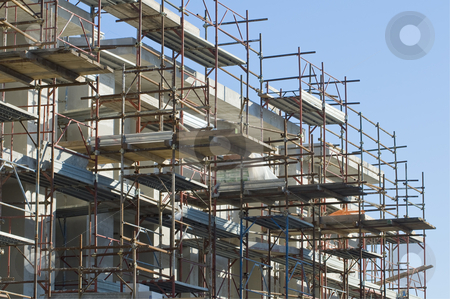 Scaffolding stock photo, Building under construction with scaffolding by Massimiliano Leban
