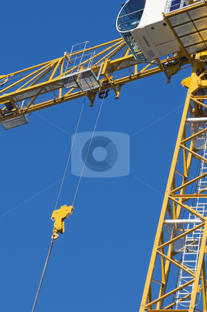 Crane stock photo, Yellow crane against a blue the sky by Massimiliano Leban
