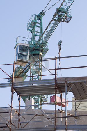 Construction site stock photo, Crane and scaffolding in a contruction site by Massimiliano Leban