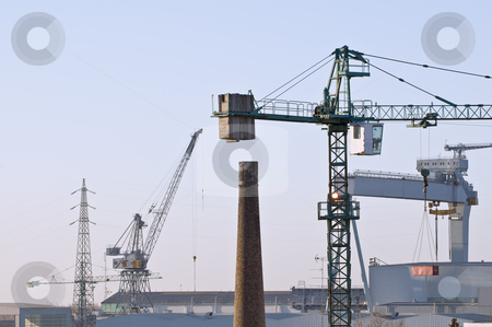 Industrial activities stock photo, Cranes, chimney, factories, high voltage pylons: different kind of industries by Massimiliano Leban