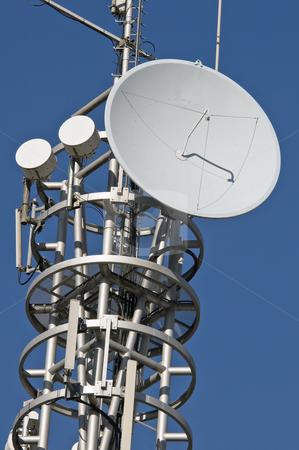 Antenna stock photo, Transmission mast with parabolic antenna against a blue sky by Massimiliano Leban